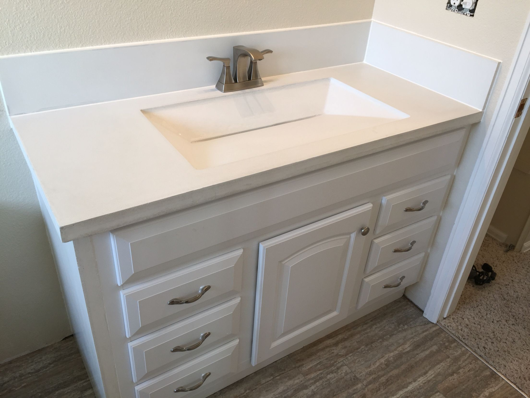 bathroom countertop with integrated sink  Custom built white concrete countertop with integrated ..