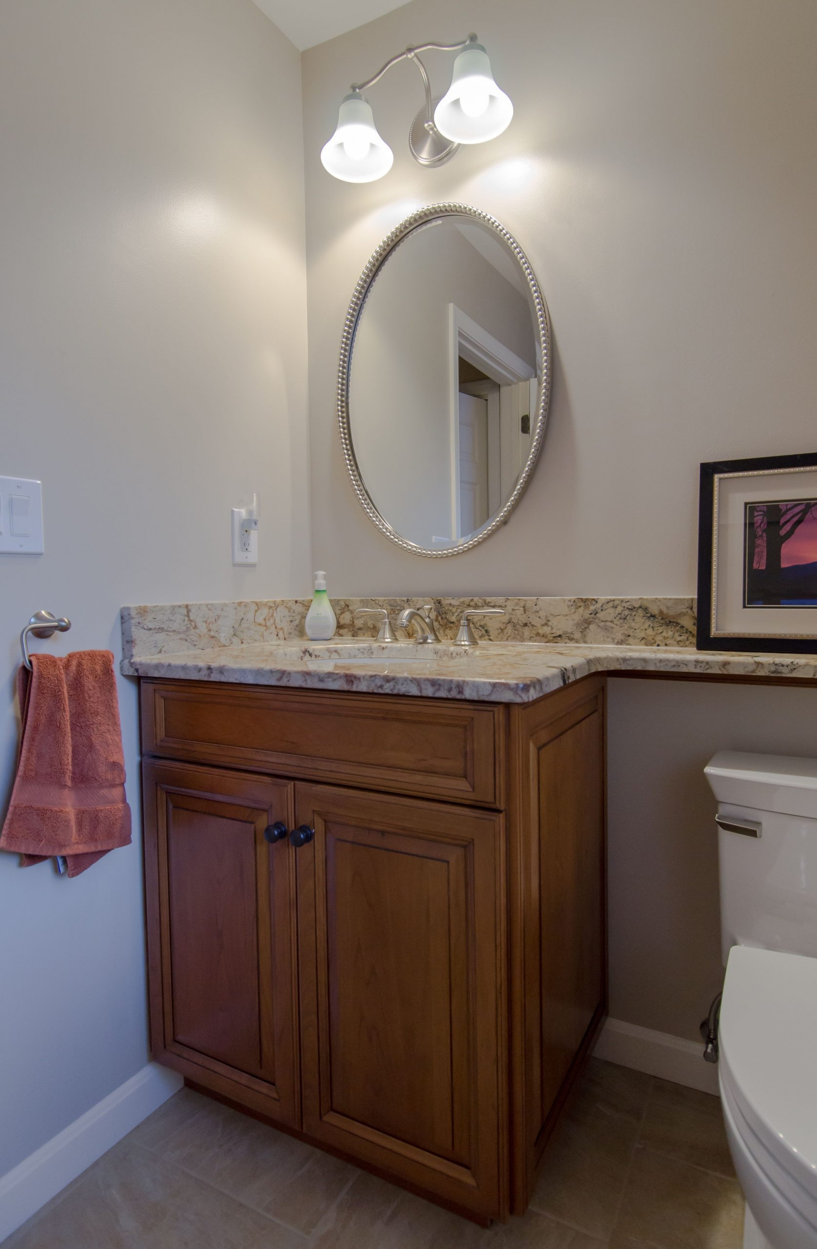 bathroom countertop overhang  Stained cherry cabinetry, granite countertop, bango ..