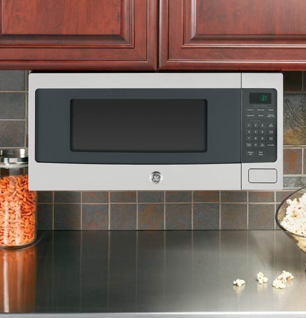 countertop microwave mounted under cabinet  Under-Cabinet mounted microwave.   Countertop microwave ..